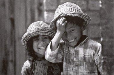 postcard-children-smile-hats-front